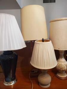 A grouping of 4 table lamps, the short 1 has a stone base!