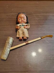 Corn cob pipe and Indian doll.