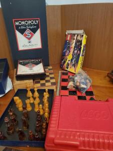 A grouping to include a vintage Monopoly game, and some legos, chess and checker sets, playing cards, and 2 backgammon games