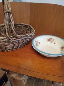 A vintage wash bowl that has been repaired and a lg. vintage basket