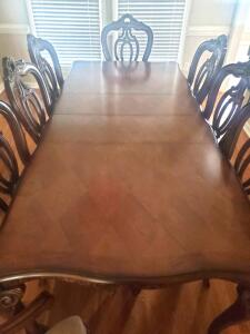 High end Fairmont designs carved, claw-foot dining table and 8 chairs, (2 are captain chairs)