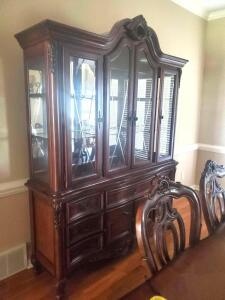 High-end fairmont designs lighted, carved, claw foot China cabinet with etched glass