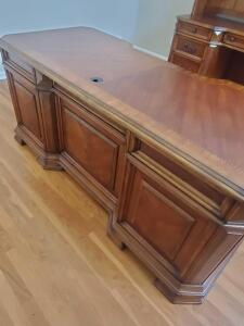 "An executive wood desk, 31"" tall, 72"" across, 32"" front to back"