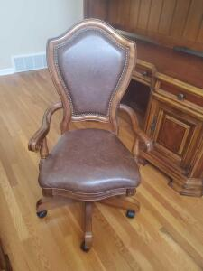 "A leather office swivel chair, seat is 19"", back is 44"", it's 24"" across, 22"" front to backit's"
