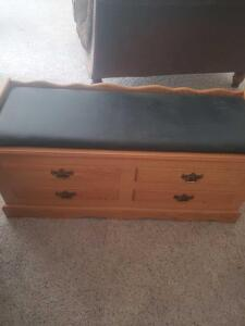 "A cedar chest with padded top, 20"" tall, 46"" across, 18"" front to back"