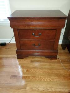 "Cherry finish 2 drawer nightstand. 27x 16 x 28"" tall."