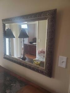 "A gold framed mirror, 30"" tall x 42"" across"