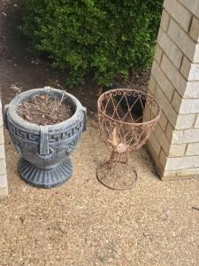 3 concrete urn planters and a metal plant holder