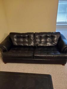 "Black bonded leather sofa. 85 x 39 x 30"" tall. Seat height is 17""."