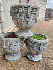 "3 concrete urn planters in front of garage. Approximate dimensions are 10' wide by 14"" tall."