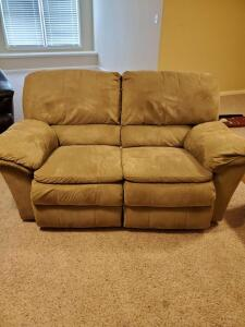 "Dual reclining microfiber loveseat. 66 x 32 x 38"" tall. Seat height is 20""."
