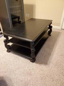 "Black distressed look coffee table with two shelves. 48 x 28 x 19"" tall."