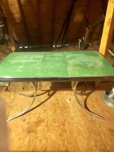 "A vintage table with a leaf, 30"" tall, 54"" across, 30"" wide"