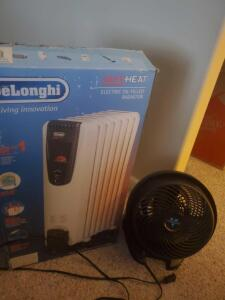 A delonghi electric oil filled radiator with original box and a vornado fan