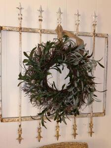 Metal fence with silk wreath decor