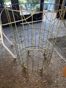 Tall metal basket on casters