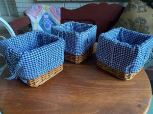 Set of three small baskets with blue and white checked cloth