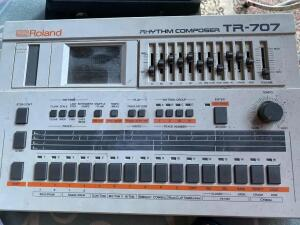 Roland TR-707 rhythm composer drum machine, Cry Baby foot pedal, drum mallets and long speaker cord
