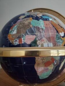 Very large blue lapis gemstone globe, with gold stand