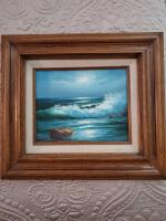 Framed oil painting of an ocean scene by artist Stevens.