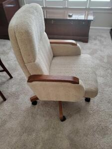 A high point chair. Swivel, rocking, desk chair, on wheels.