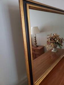 A drexel heritage mirror, frame is black and gold