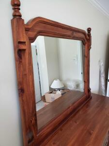 Large singer furniture mirror beautifully framed in wood.
