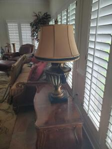A detailed urn style lamp