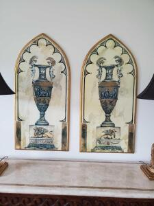 A pair of arch shape pictures with urn.