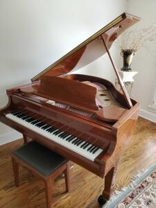 Exquisite high end Samic baby grand piano.