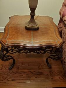 Beautiful end table. Leather top and iron legs.