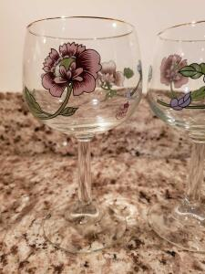 8 royal Daulton wine glasses with flower.