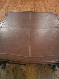 Leather topped and iron coffee table