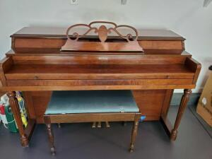 Beautiful Sterling brand piano with bench.
