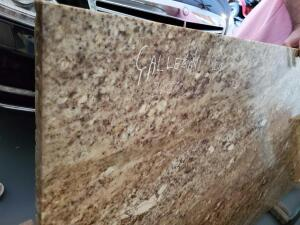 "Solid granite piece. 36""x70""x 1.25"" thick"