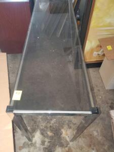 "A glass top sofa table, 30"" tall, 54"" across, 16"" front to back"