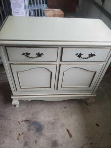 "A vintage storage cabinet with a front that pulls out for storage, 28"" tall, 30"" across, 16"" front to back"