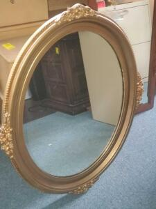 A vintage oval mirror with solid/sturdy, gold color frame, 36 x 30