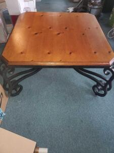 A vintage IRON coffee/center table with a solid wood top