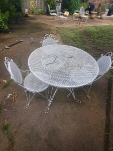 "A metal patio table and 3 chairs. Table is 28"" tall, 36"" diameter, chair seat is 16"" tall, back is 32"""