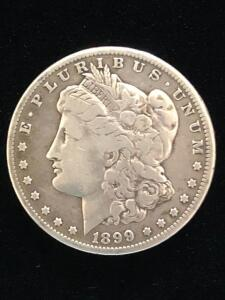 1899 US One Dollar Silver coin. VG condition, cleaned