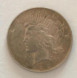 1927 US Peace Silver Dollar. Fine condition.