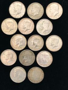 Bag of 14 Kennedy Half Dollars from the late 1960s.