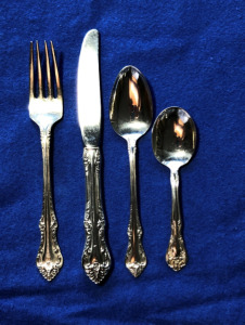 "International Sterling Wild Rose One 4 piece Youth place setting: 1 Knife 6 1/2"", 1 Fork 6"", 1 Spoon 5 1/2"" and 1 Spoon 4 1/4"""