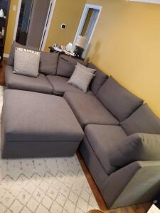 4 piece Sectional sofa and ottoman in gray tweed upholstery.