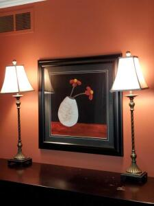 "A pair of buffet lamps 32"" tall and a double matted and framed print of pottery vase with flowers. 28 x 29."