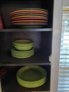 Large grouping of Dinnerware in kitchen cabinet. Most are studio 33.