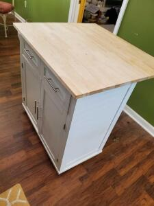 White Portable Kitchen island with drop down shelf.