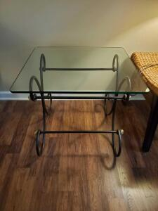 "Glass top end table on scrill work iron base. 27 x 24 x 23"" tall."