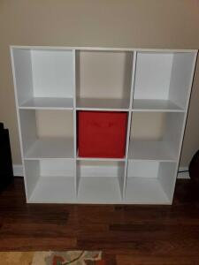 "9 cube storage shelf with one red basket. 36 x 12 x 36"" tall."